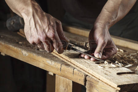 45514539-closeup-of-a-carpenter-hands-working-with-a-chisel-and-carving-tools-on-wooden-workbench.jpg